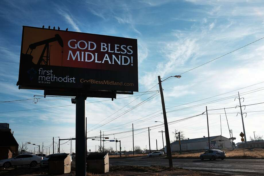 MIDLAND, TX - FEBRUARY 06: A billboard promotes the oil industry along a road in Midland on February 6, 2015 in Midland, Texas. As crude oil prices have fallen nearly 60 percent globally, American communities dependent on oil revenue prepare for hard times. Texas, which benefited from hydraulic fracturing and the shale drilling revolution, tripled its production of oil in the last five years. The Texan economy saw hundreds of billions of dollars come into the state before the global plunge in prices. Across the state drilling budgets are being slashed and companies are notifying workers of upcoming layoffs. According to federal labor statistics, around 300,000 people work in the Texas oil and gas industry, 50 percent more than four years ago. (Photo by Spencer Platt/Getty Images) Photo: Spencer Platt/Getty Images