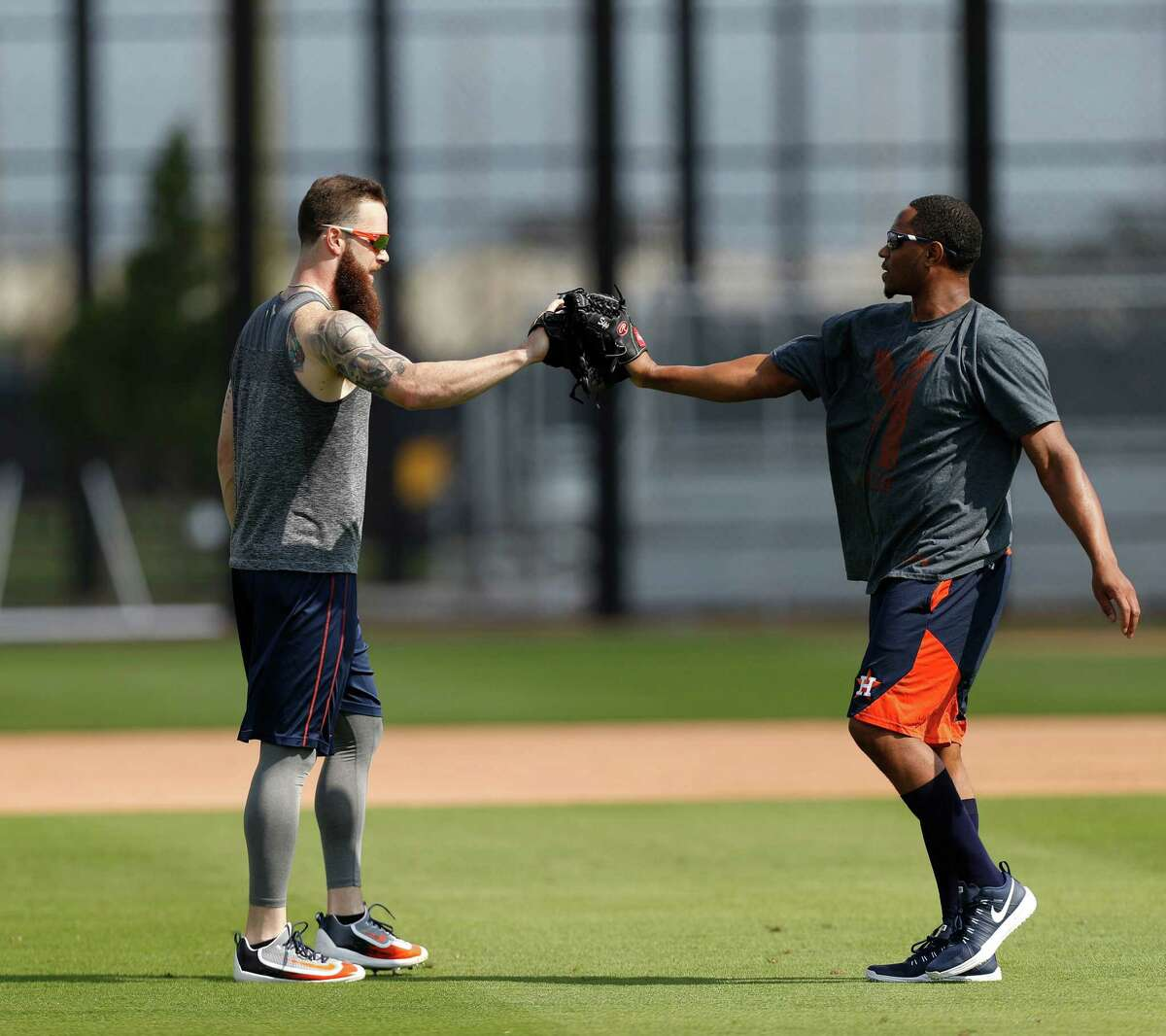 Houston Astros starting pitcher Dallas Keuchel glove bumps reliever Tony Sipp after they played catch during Astros pitchers and catchers report day at the Astros new spring training facility, The Ballpark of the Palm Beaches, in West Palm Beach, Florida, Tuesday, February 14, 2017. The Astros share the new ballpark with the Washington Nationals.