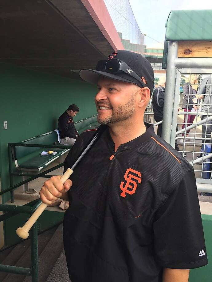 Cody Ross, fungo in hand, prepares for his first day as a Giants instructor. Photo: Henry Schulman, San Francisco Chronicle