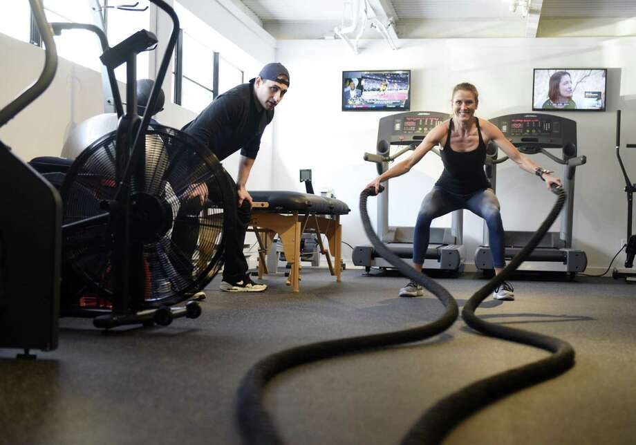 Personal trainer Paul Cortesi assists Greenwich resident Amy Lewis with a workout at In Forma Fitness on West Putnam Avenue in Greenwich, Conn. Monday, Feb. 13, 2017. In Forma is a private gym that allows freelance personal trainers to rent the space for a nominal fee to train their clients. Photo: Tyler Sizemore / Hearst Connecticut Media / Greenwich Time