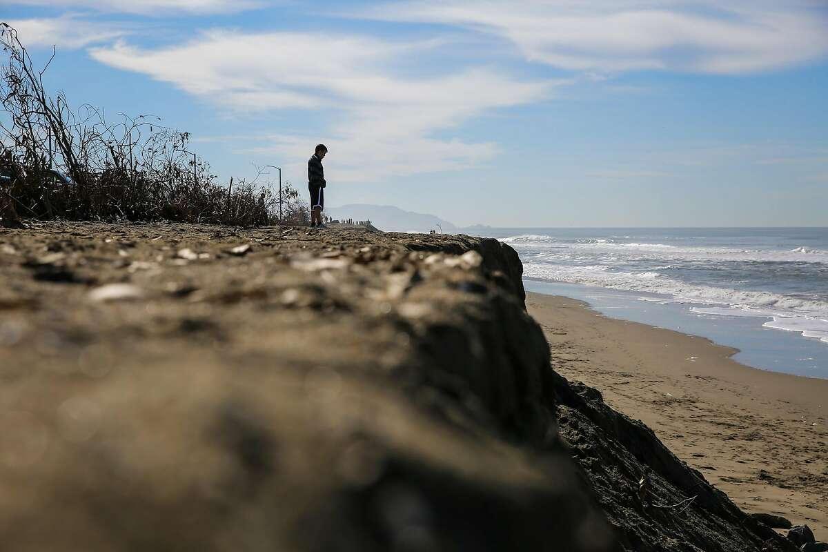 A man looks out onto Ocean Beach in San Francisco, California, on Tuesday, Feb. 14, 2017.