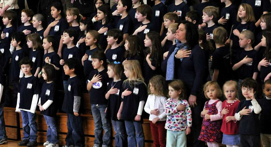 Ridgefield Academy students pledge allegience to the flag during Opening Ceremonies of the 2010 Ridgefield Academy Winter Olympics on Friday, Feb.12,2010. At bottom right are, Frankie Belden,Madi Torchen, and Noah Davis, all 3 years old. Photo: Michael Duffy / ST / The News-Times