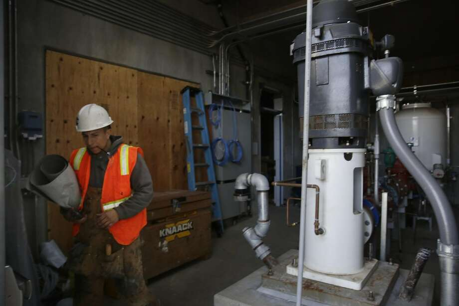 Israel Rivera works near a well pump at the West Sunset station as the city prepares to blend ground and Sierra water. Photo: Lea Suzuki, The Chronicle