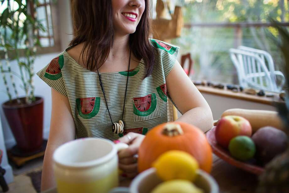 Arist Jennie Lennick's textiles, utilized in clothes and pillows, are dotted with colorful fruits: pineapples, bananas, strawberries and lemons. Lennick creates the print by dipping wooden stamps in dye, and hand-painting the little details. Photo: Jenny Lemons