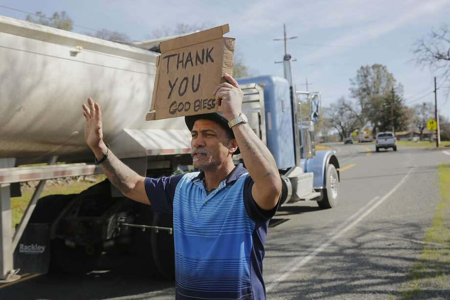 Evacuees Jeff Martinez, thanks rock hauling truck drivers as they pass by while staying at the Bangor Community Center evacuation site on Tuesday Feb. 14, 2017, in Bangor, Ca. Photo: Michael Macor, The Chronicle