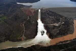 The Oroville Dam spillway releases 100,000 cubic feet of water per second down the main spillway in Oroville, California on February 13, 2017. Almost 200,000 people were under evacuation orders in northern California Monday after a threat of catastrophic failure at the United States' tallest dam.