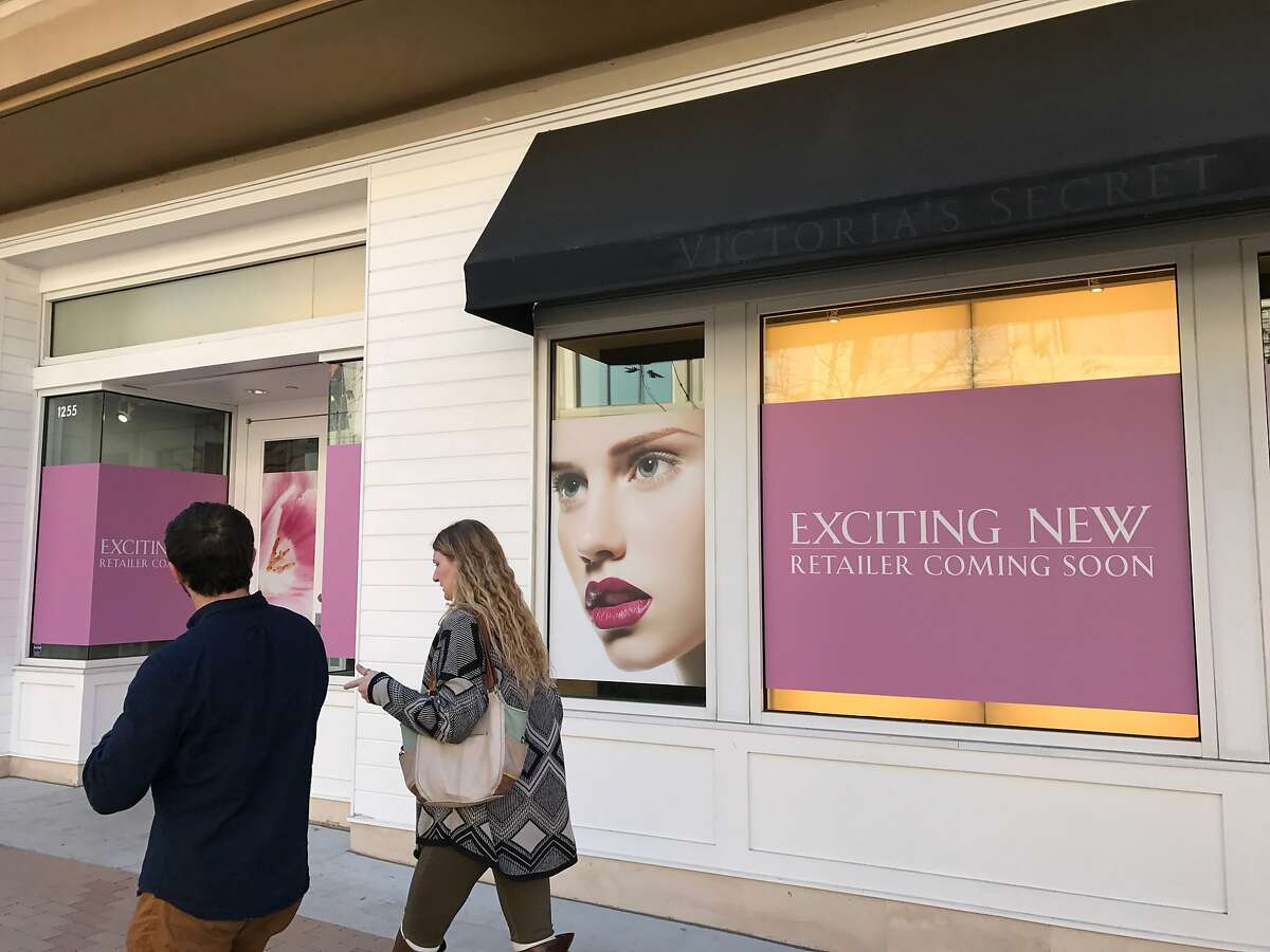Shoppers walk past the future site of an Amazon Books store in Broadway Plaza, an open-air shopping center in Walnut Creek.