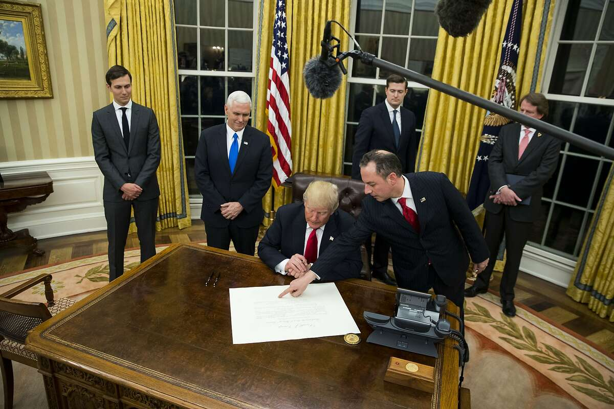 President Donald Trump signs a broadly-worded executive order directing agencies to scale back aspects of the Affordable Care Act, at the White House in Washington, Jan. 20, 2017. The executive order should be seen more as a mission statement, and less as a monarchical edict to instantly change the law. (Doug Mills/The New York Times)