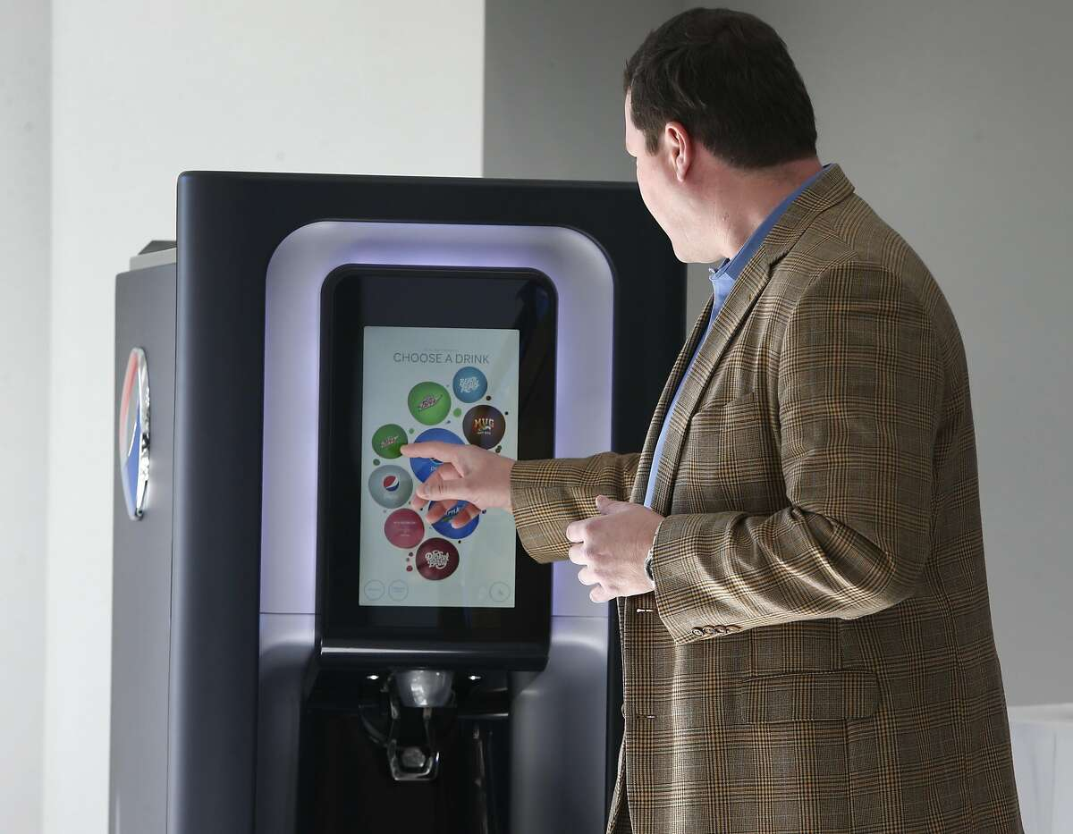 Darren Koenig, senior director of digital innovation and IoT for Pepsico, operates his company's smart soft drink dispenser at the AT&T labs in San Ramon, Calif. on Tuesday, Feb. 14, 2017. AT&T is launching its LTE-M network nationwide by the middle of 2017 to accommodate Internet of Things devices operating wirelessly.