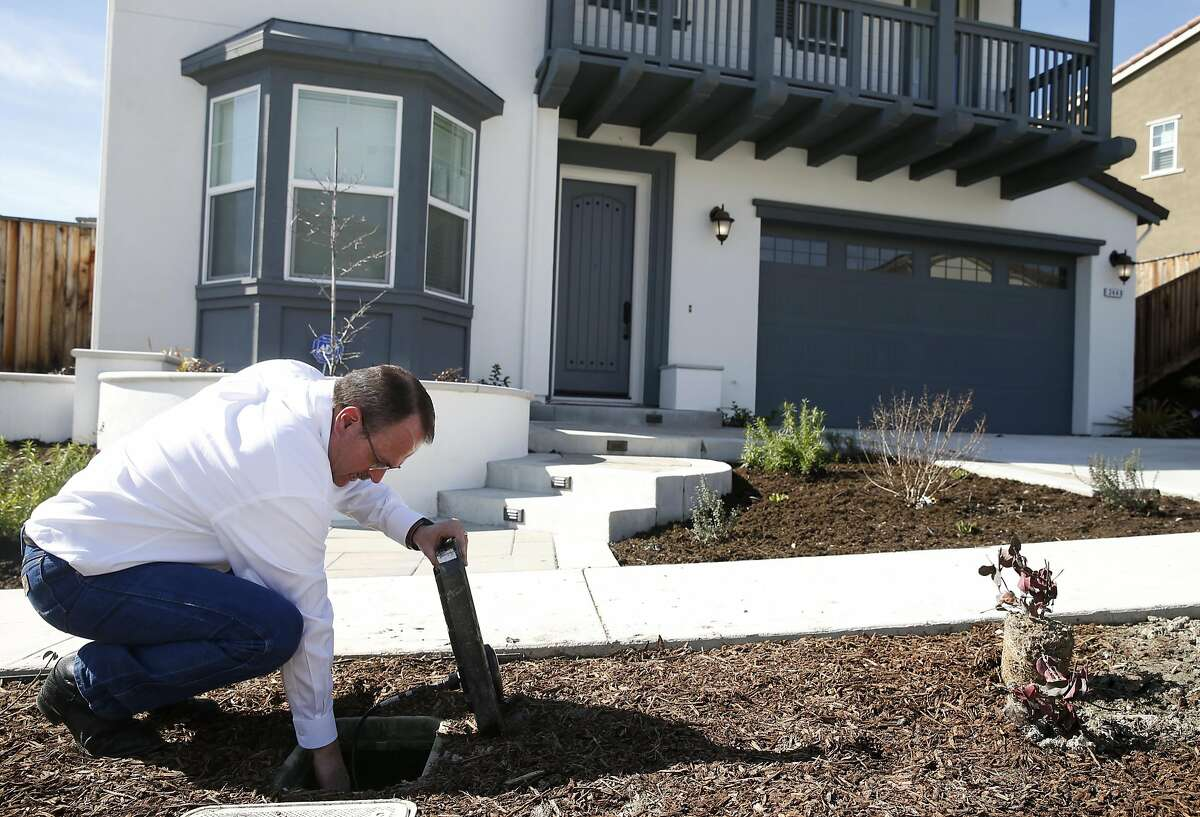 Capstone Metering CEO Scott Williamson inspects a smart water meter developed by his company and connected via AT&T's new LTE-M network at a customer's home in San Ramon, Calif. on Tuesday, Feb. 14, 2017. AT&T is launching its LTE-M network nationwide by the middle of 2017 to accommodate Internet of Things devices operating wirelessly.