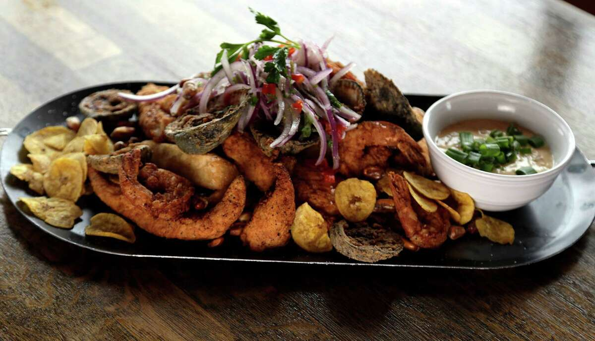 """Andes Cafe is among the Houston restaurants participating in the Houston Chronicle's 2017 Culinary Stars dining event on Sept. 14. Shown: The Super Jalea Platter, crispy fresh fried seafood mix, side of yucca sticks, rocto tartar sauce, """"salsa crilla"""" (red onions, lime, aji limo, cliantro) and canchita at Andes Cafe."""