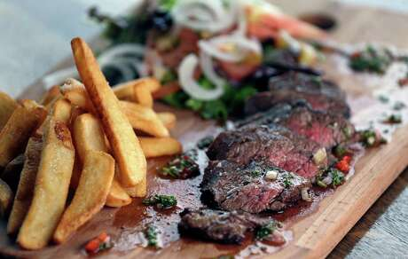 The Churrasco Al Plato, charcol grilled 8 oz. skirt steak, with chimichurri sauce, french fries and house salad at Andes Cafe Tuesday, Jan. 17, 2017, in Houston.