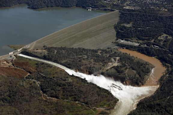 Water flows out of the damaged spillway at Oroville Dam in Oroville, Calif., on Tuesday, February 14, 2017.