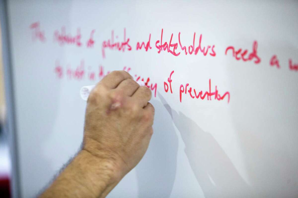 A workshop attendee writes on a whiteboard during a seminar of the TMCx accelerator program at the Texas Medical Center on Tuesday, Feb. 14, 2017, in Houston. The TMCx accelerator program, focusing on health and hospital IT applications, began workshops with 24 new startups on Tuesday. ( Brett Coomer / Houston Chronicle )