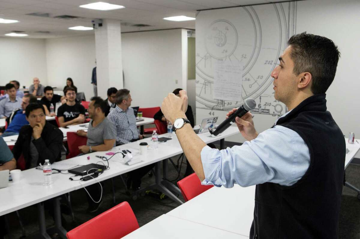 Instructor Farzad Soleimani speaks to attendees during a workshop of the TMCx accelerator program.