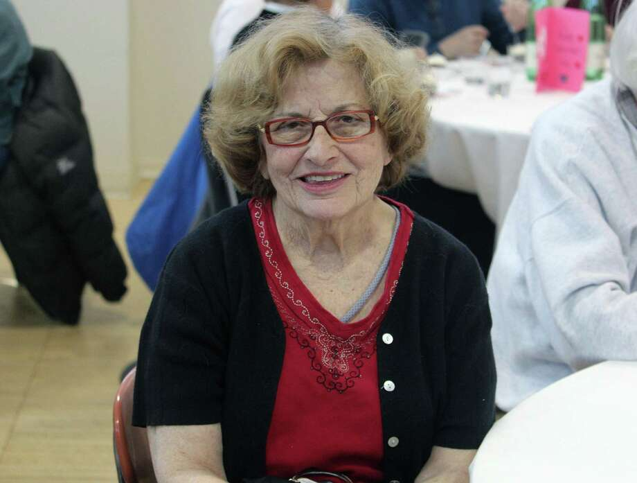 Elizabeth Thomas, 86, had a Valentine's treat a day early when she got engaged to Lou Bello, 90, who she met at the Bigelow Center for Senior Activities in Fairfield, Conn. a year and a half ago. She was photographed during a Feb. 14, 2017 luncheon at the senior center. Photo: Laura Weiss / Hearst Connecticut Media / Fairfield Citizen