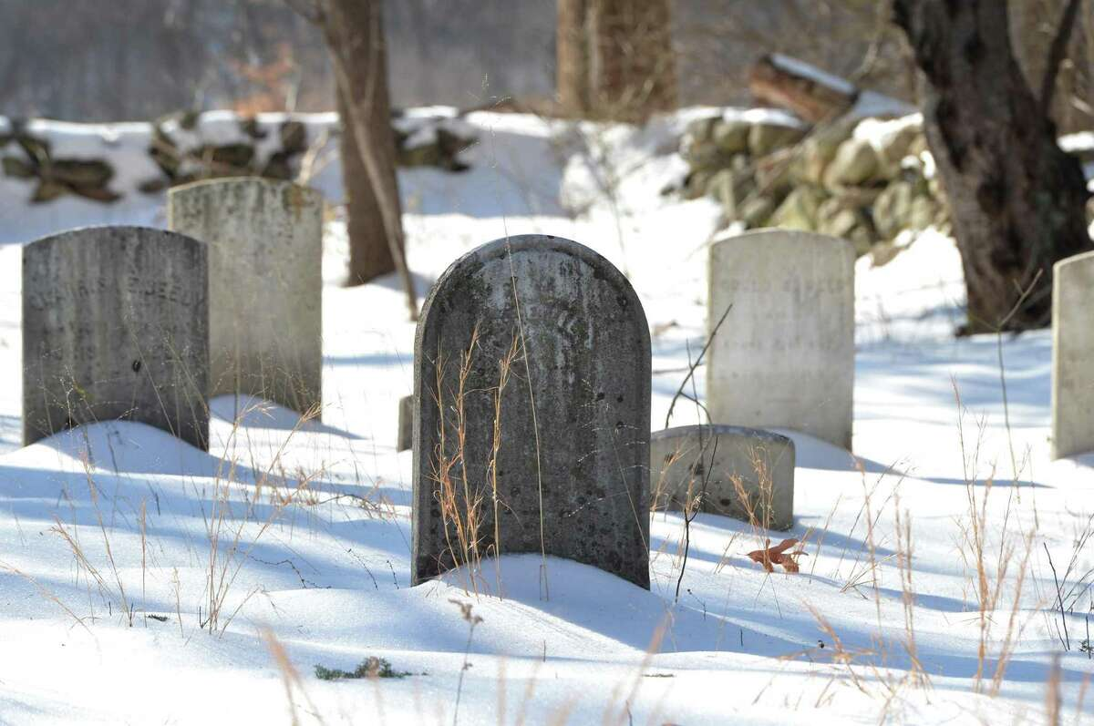 Gravestones at the Reed Cemetery on the west side of Brookside Road which was thought to be Darien is actually in Norwalk on Tuesday.