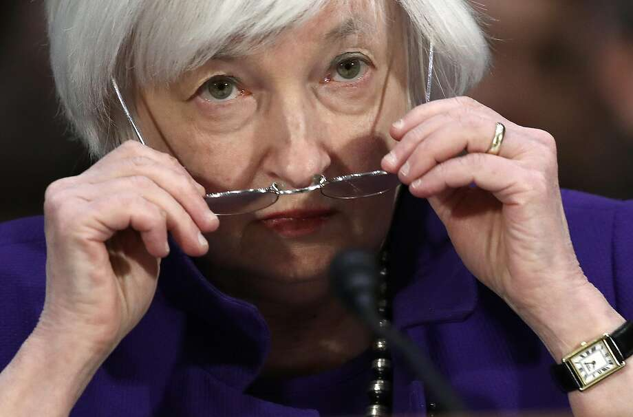 Federal Reserve Chairwoman Janet Yellen tells a Senate committee that interest rates will go up again this year, but she was not specific about when. Photo: Win McNamee
