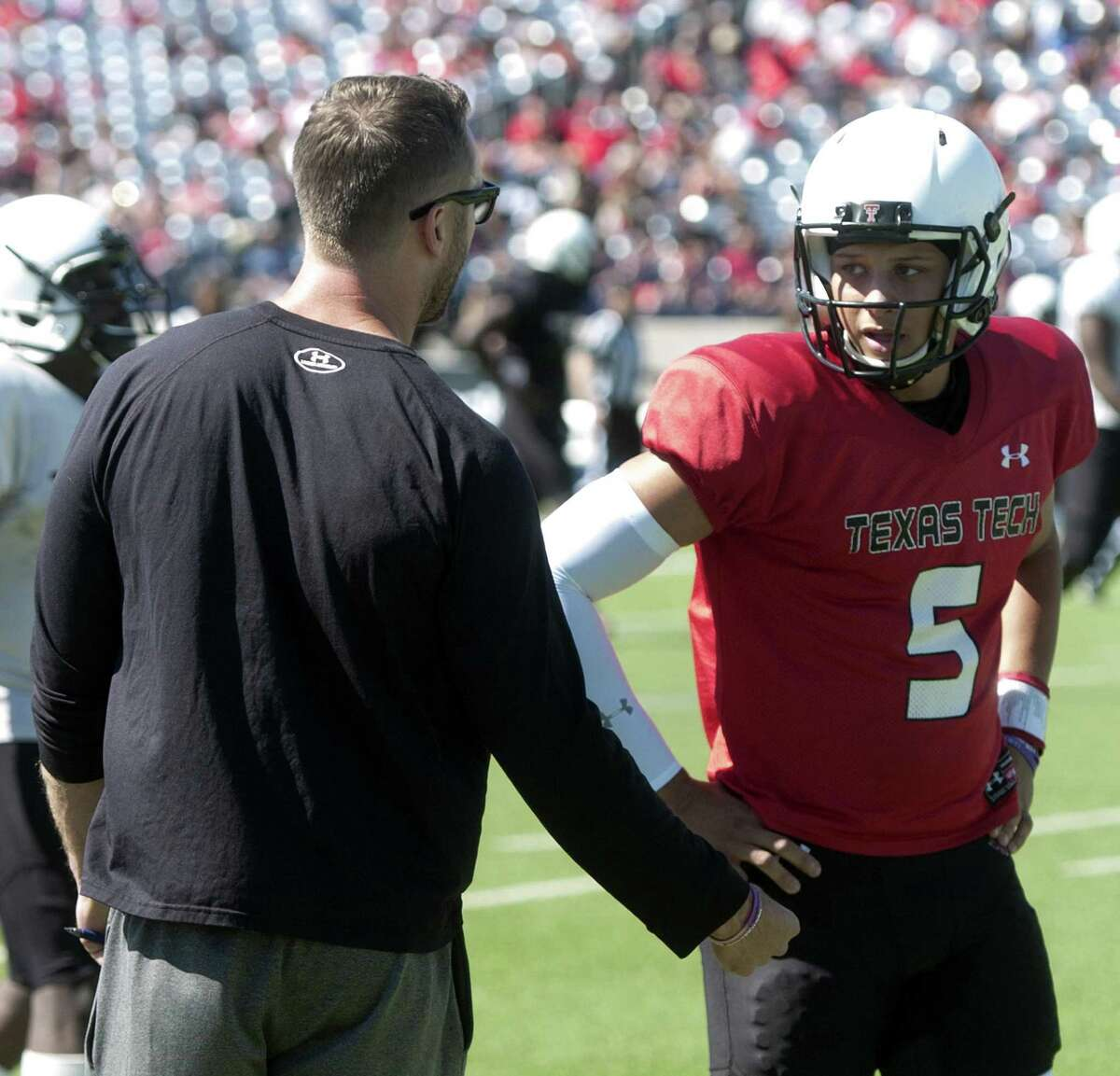 Texas Tech head coach Kliff Kingsbury talks with quarterback Patrick Mahomes during the spring scrimmage on March 28, 2015, at Grande Communications Stadium in Midland.