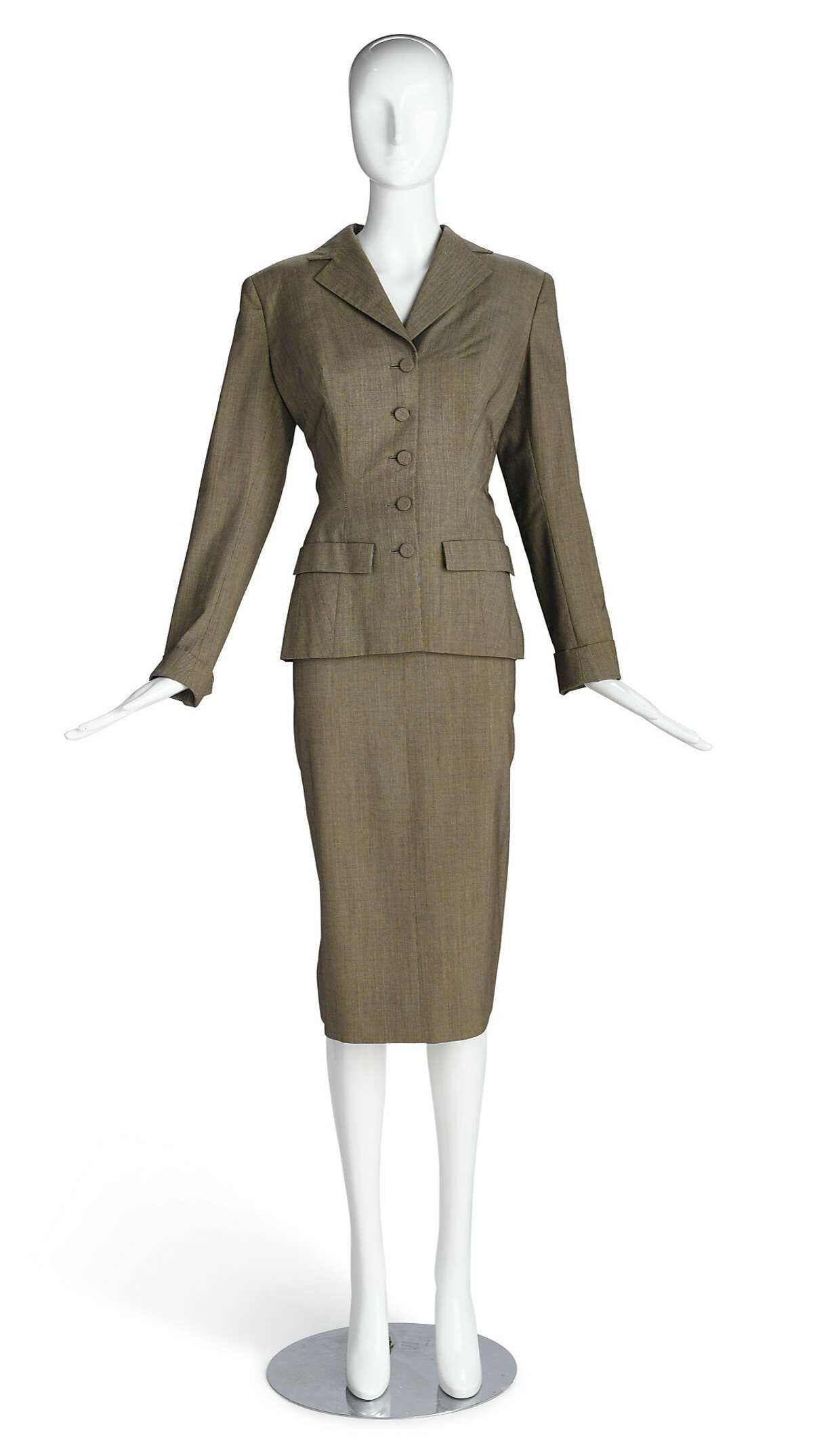 """The gray suit Kim Novak wore in """"Vertigo"""" was auction last fall by�Bonhams�in Los Angeles. The seller had picked up the item at a vintage clothes store, not knowing the suit�s provenance. Only later did a tag inside indicate its place in film history. Selling price: $28,750."""