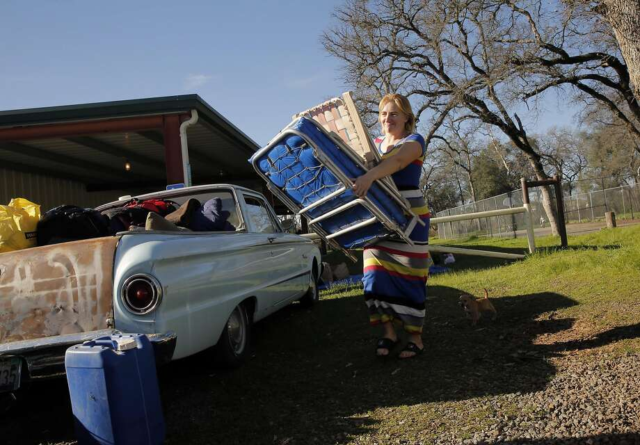 Cindy Olson packs up their belongings and head for Chico, from the Bangor Community Center evacuation site on Tuesday Feb. 14, 2017, in Bangor, Ca., as the Oroville Dam mandatory evacuation order had been downgraded to voluntary. They were still not convinced to return to Oroville and decided to wait int out north of Oroville. Photo: Michael Macor, The Chronicle