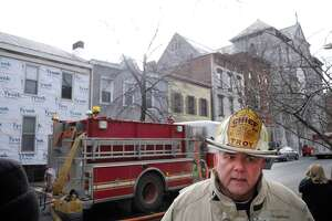 Troy Fire Chief Thomas Garrett talks to the media at the scene of a house fire at 184 Third Street on Monday, Feb. 6, 2017, in Troy, N.Y.   (Paul Buckowski / Times Union)