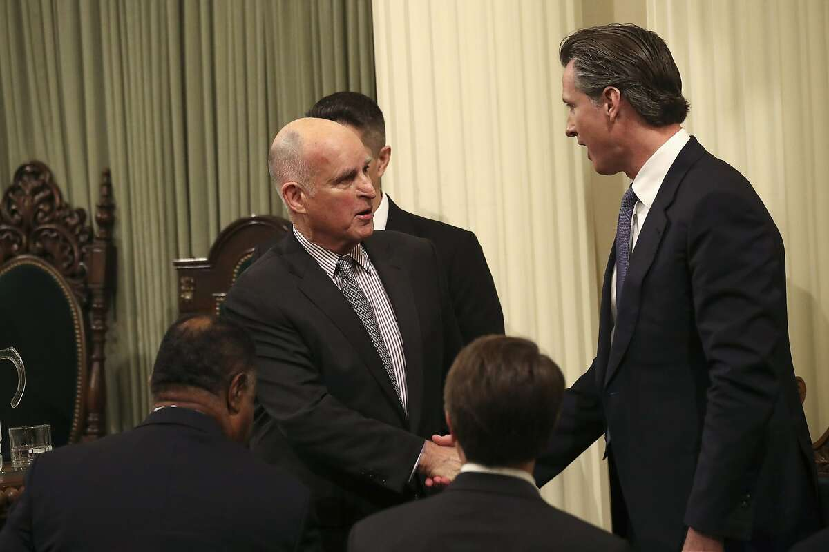 Gov. Jerry Brown shakes hands with Lt. Gov Gavin Newsom after delivering his State of the State address in Sacramento, Jan. 24, 2017. Brown on Tuesday swore in Rep. Xavier Becerra, who is stepping down from his U.S. House seat to take the post, as his new attorney general. (Jim Wilson/The New York Times)
