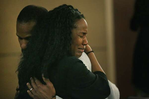 Qwalion Busby, left, charged with injury to a child by omission in regard to his son, who died after a severe infection in 2015, is embraced by a grieving family member after hearing the guilty verdict read in the Cadena-Reeves Justice Center, on Tuesday, Feb. 14, 2017. Busby and his wife Marquita Johnson were found guilty.