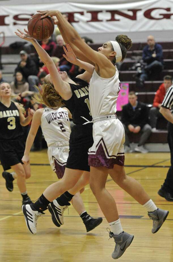 Bethel's Amanda Towey (10) blocks a shot by Barlow's Kinsey Colby (15) in the girls high school basketball game between Joel Barlow and Bethel high schools on Tuesday night, February 14, 2017, at Bethel High School, in Bethel, Conn. Photo: H John Voorhees III / Hearst Connecticut Media / The News-Times
