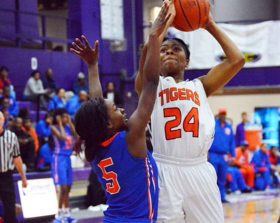 Edwardsville junior forward Myriah Noodel-Haywood, right, goes up for a shot over East St. Louis defender Nia Mccaskill in the third quarter of Tuesday's game in Collinsville.