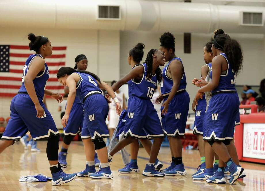 The Willowridge Lady Eagles celebrate after defeating the Madison Lady Marlins during the Region III-5A bi-district playoff game at Butler Field House in Houston, TX on Tuesday, February 14, 2017. Photo: For The Chronicle / Houston Chronicle
