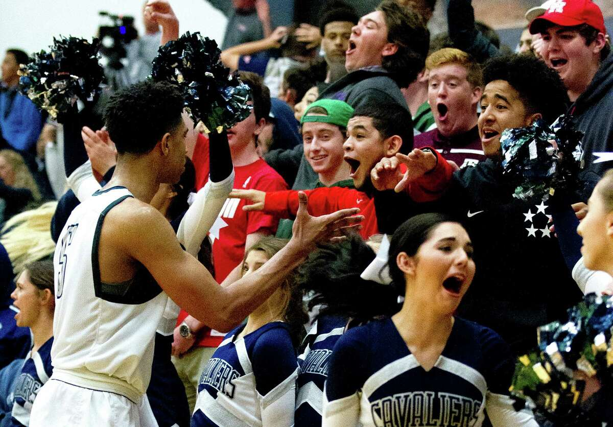 COLLEGE PARK 87, CONROE 71 College Park fans react after a buzzer beating three-pointer by guard Quentin Grimes to end the third quarter of a District 12-6A high school boys basketball game at College Park High School Tuesday, Feb. 14, 2017, in The Woodlands. College Park defeated Conroe 87-74.