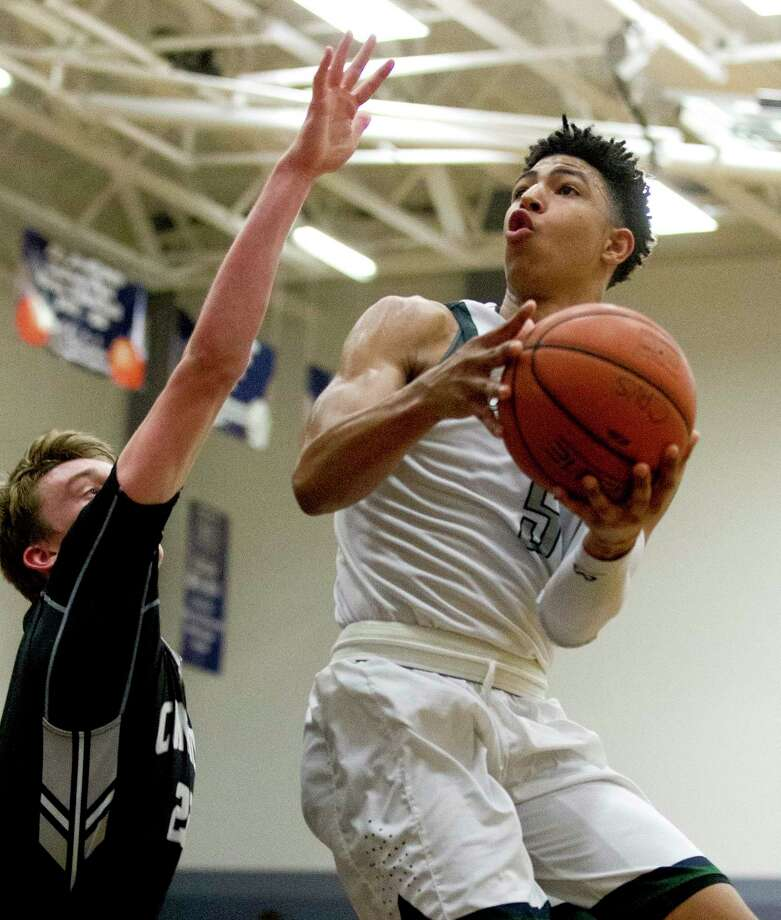 College Park guard Quentin Grimes (5) shoots over Conroe guard Blaine Alger (22) during the third quarter of a District 12-6A high school boys basketball game at College Park High School Tuesday, Feb. 14, 2017, in The Woodlands. College Park defeated Conroe 87-74. Photo: Jason Fochtman, Staff Photographer / © 2017 Houston Chronicle