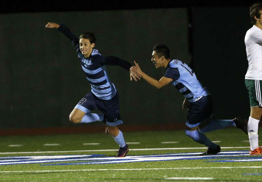Johnson's Brandon Bradford (left) celebrates his goal with teammate Jose Silerio during a District 26-6A high school soccer game against Reagan on Feb. 14, 2017. Photo: Ron Cortes /For The Express-News / Freelance