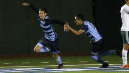 Johnson's Brandon Bradford (left) celebrates his goal with teammate Jose Silerio during a District 26-6A high school soccer game against Reagan on Feb. 14, 2017.