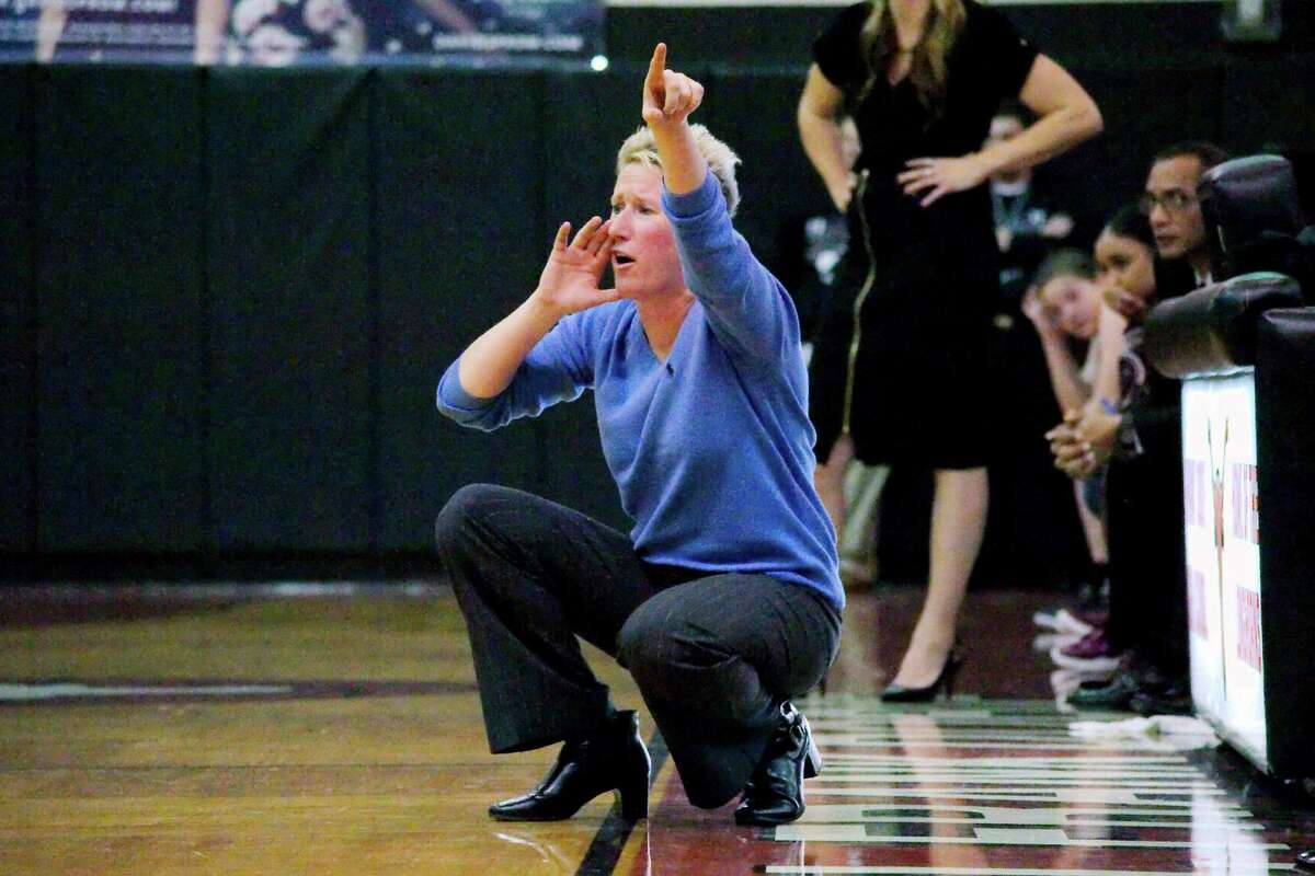 Clear Lake basketball coach Kirby Killingsworth shouts instructions during the game against Pearland Tuesday, Feb. 14 at Dobie High School.