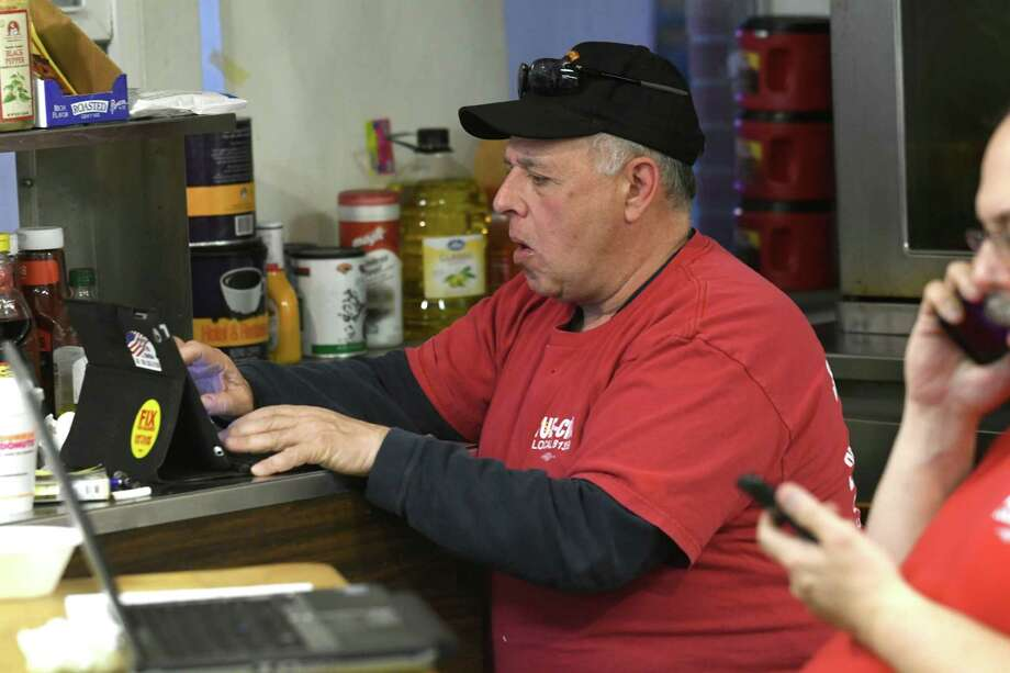 IUE-CWA Local 81359 president Dom Patrignani is seen at his computer looking at results on a vote, that passed, for a tentative labor contract to settle the strike at Momentive Performance Materials on Tuesday, Feb. 14, 2017 in Waterford, N.Y. (Lori Van Buren / Times Union) Photo: Lori Van Buren / 20039683A