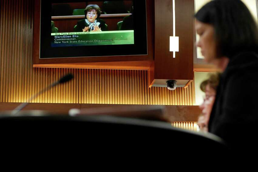 New York State Education Department Commissioner MaryEllen Elia is seen on a monitor in the hearing room showing the live feed as she testifies before a joint Legislative Budget Hearing on Elementary and Secondary Education on Tuesday, Feb. 14, 2017 in Albany, N.Y. (Paul Buckowski / Times Union)