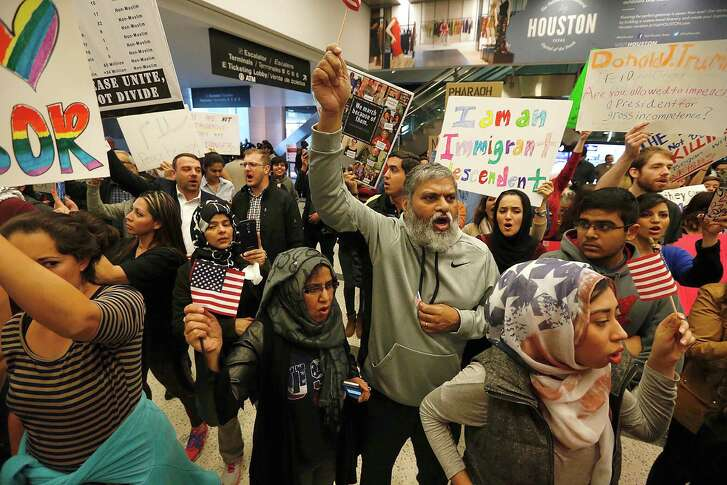 Demonstrators chant as they protest anti-immigrant policies and a Muslim travel ban instituted via executive order by the Trump administration as they fill the international arrivals area at George Bush Intercontinental Airport on Sunday, Jan. 28, 2017, in Houston. ( Brett Coomer / Houston Chronicle )