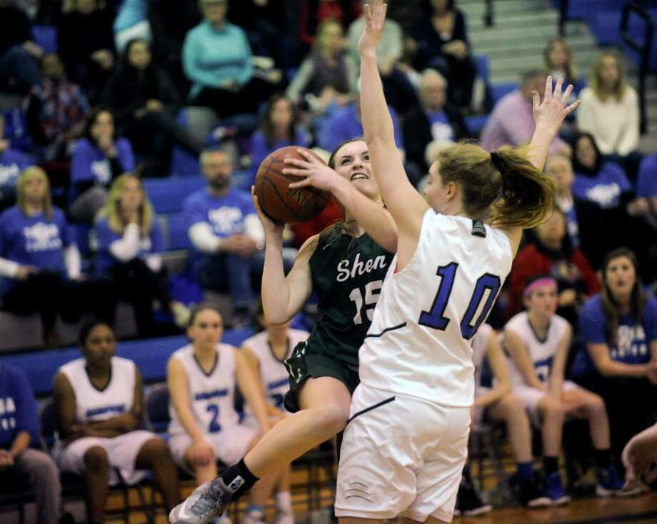 Shenendehowa's  Megan Gillooley (15) moves the ball against Saratoga's Kerry Flaherty (10) during the first half of a girls' Section II Class AA high school basketball game on Tuesday, Feb. 214, 2017, in Saratoga Springs, N.Y. (Hans Pennink / Special to the Times Union) ORG XMIT: HP101 Photo: Hans Pennink / Hans Pennink