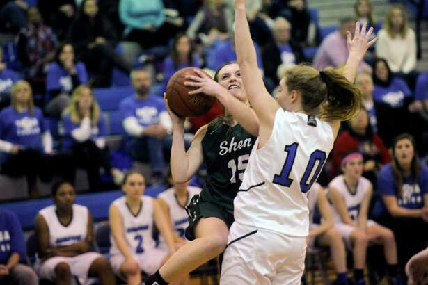 Shenendehowa's  Megan Gillooley (15) moves the ball against Saratoga's Kerry Flaherty (10) during the first half of a girls' Section II Class AA high school basketball game on Tuesday, Feb. 214, 2017, in Saratoga Springs, N.Y. (Hans Pennink / Special to the Times Union) ORG XMIT: HP101