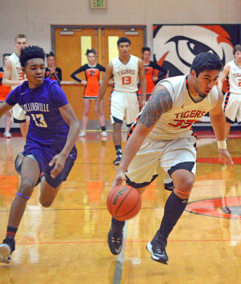 Edwardsville senior AJ Epenesa drives to the basket during the second quarter of Tuesday's Southwestern Conference game against Collinsville at EHS.