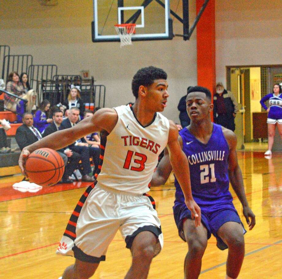 Edwardsville senior Mark Smith dribbles past Collinsville defender Jaaron Williams.