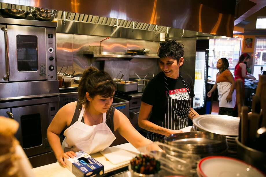 "Marisol Heredia, left, and Preeti Mistry, head chef and owner, prep food together at Juhu Beach Club in Oakland, one of the Bay Area restaurants that has sought ""sanctuary"" status. Photo: Mason Trinca, Special To The Chronicle"
