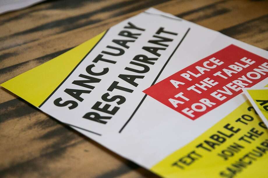 Sanctuary Restaurant posters rest on the counter at Juhu Beach Club. Photo: Mason Trinca, Special To The Chronicle