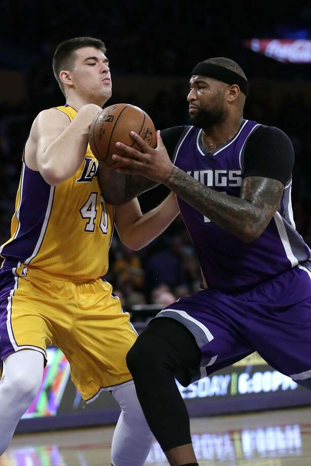The Lakers' Ivica Zubac (left) tries to cover the Kings' DeMarcus Cousins, who had 40 points. Photo: Robert Gauthier, TNS