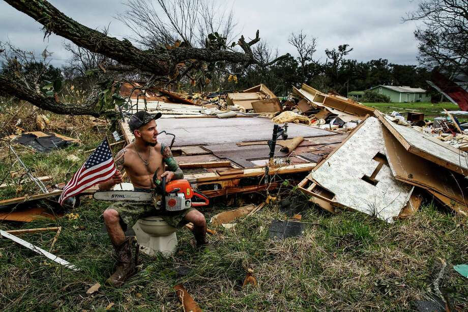 Hunter Brown poses for a photo with an american flag and a chainsaw while sitting on a toilet from a trailer that was destroyed when a tornado came through the area early Tuesday, Feb. 14, 2017 in Van Vleck. Photo: Michael Ciaglo, Houston Chronicle / Michael Ciaglo