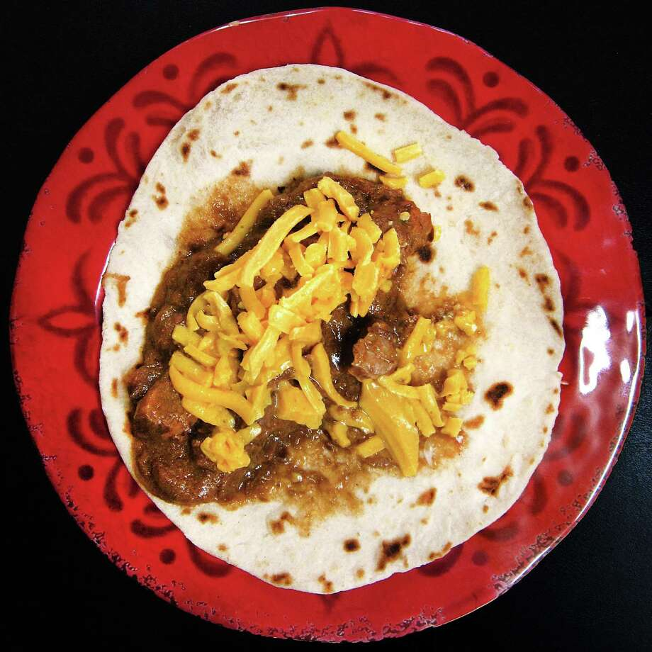 Carne guisada taco with cheese on a handmade flour tortilla from Oblate Cafe. Photo: Mike Sutter /San Antonio Express-News