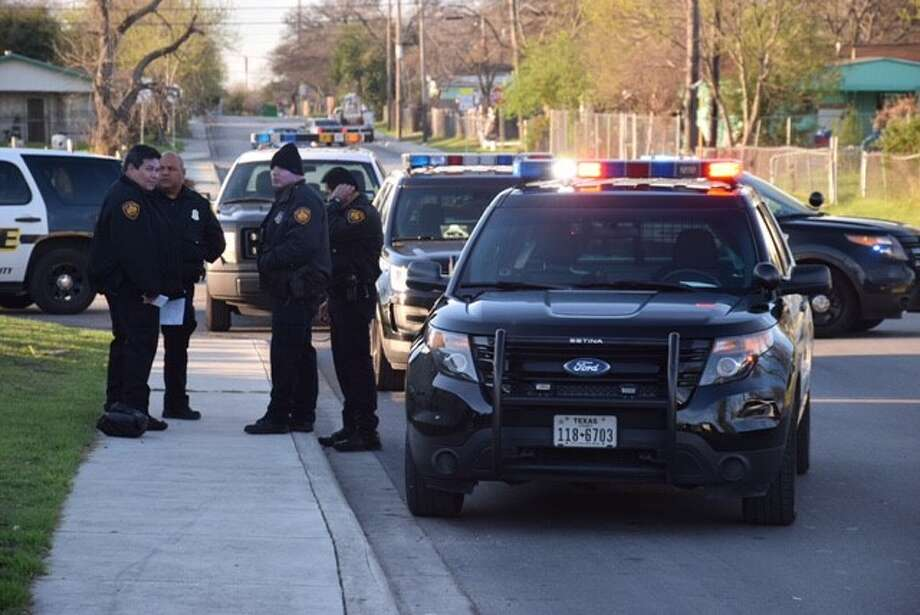 San Antonio police are investigating a crime scene involving a man who allegedly attacked his mother's boyfriend with brass knuckles and a shovel at the intersection of 28th and Menchaca Streets on Wednesday, Feb. 15, 2017. Photo: Caleb Downs / San Antonio Express-News