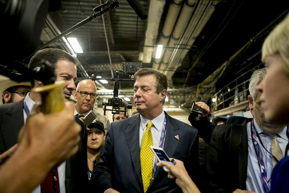 Paul Manafort, President Donald Trump's former campaign manager, speaks to reporters during the Republican National Convention in Cleveland in July 2016. Phone records and intercepted calls show that members of Trump's 2016 campaign and other associates, including Manafort, had repeated contacts with senior Russian intelligence officials in the year before the election, according to four current and former senior American officials. Photo: SAM HODGSON, NYT
